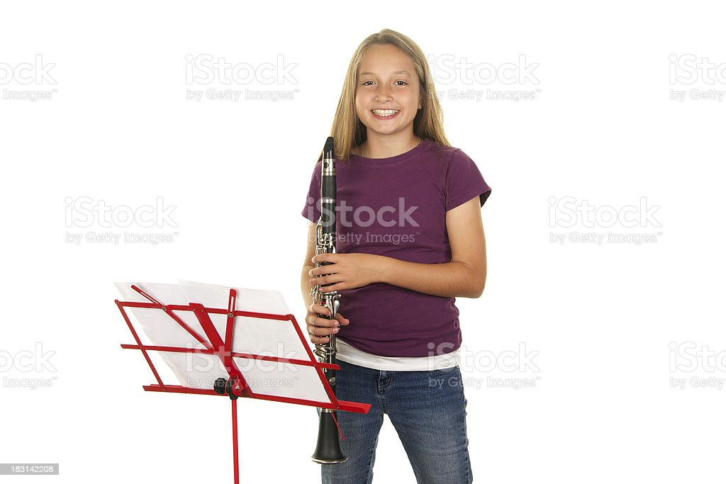 Cute Eleven Year Old Girl Smiling with Clarinet royalty-free stock photo