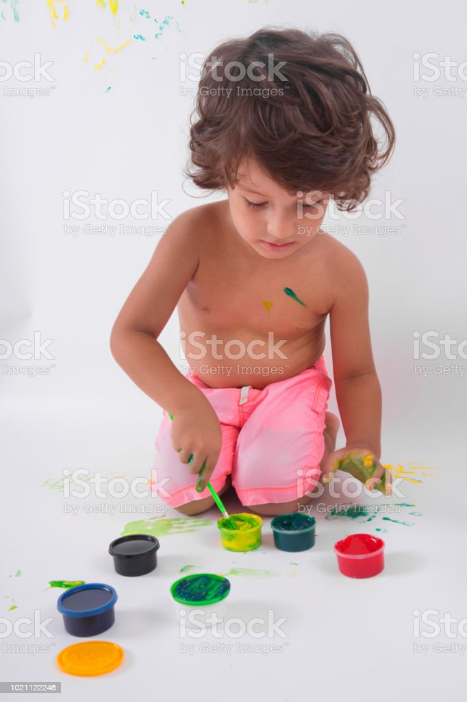 Cute excited boy with hands full of finger paint.  Photos Cute excited boy with hands full of finger paint stock photo