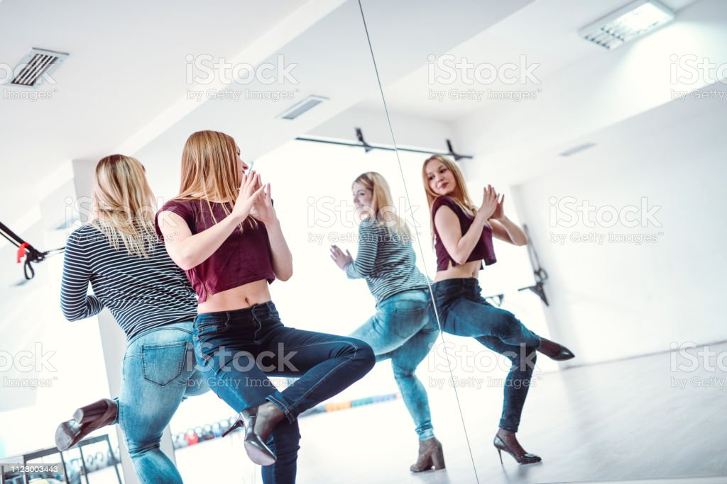 Cute Excited Females Getting Ready For Their Daily Fitness Training stock photo