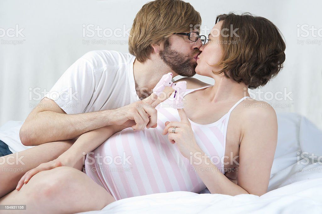 Cute expecting couple playing with puppets. royalty-free stock photo