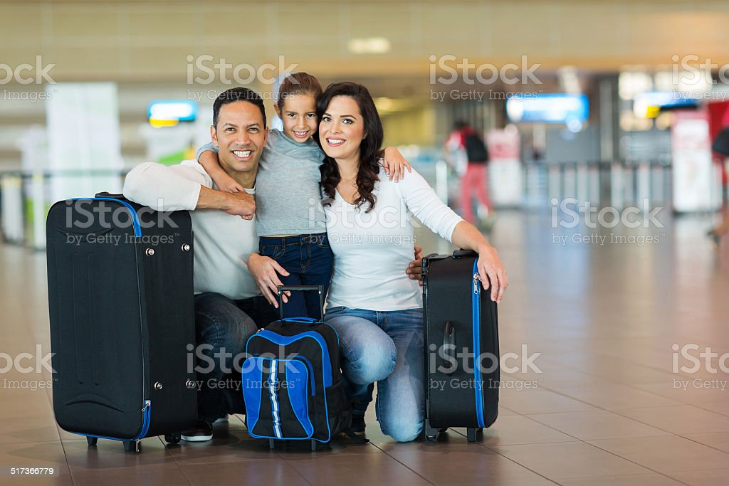 cute family at airport stock photo