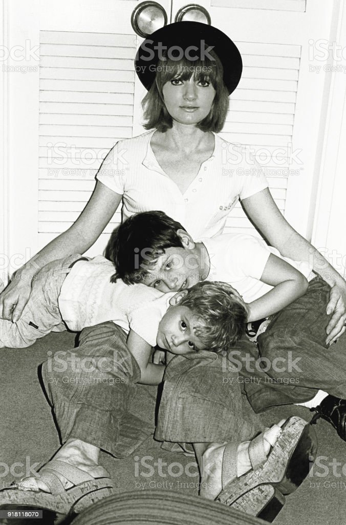 Cute family of the seventies in playful pose stock photo