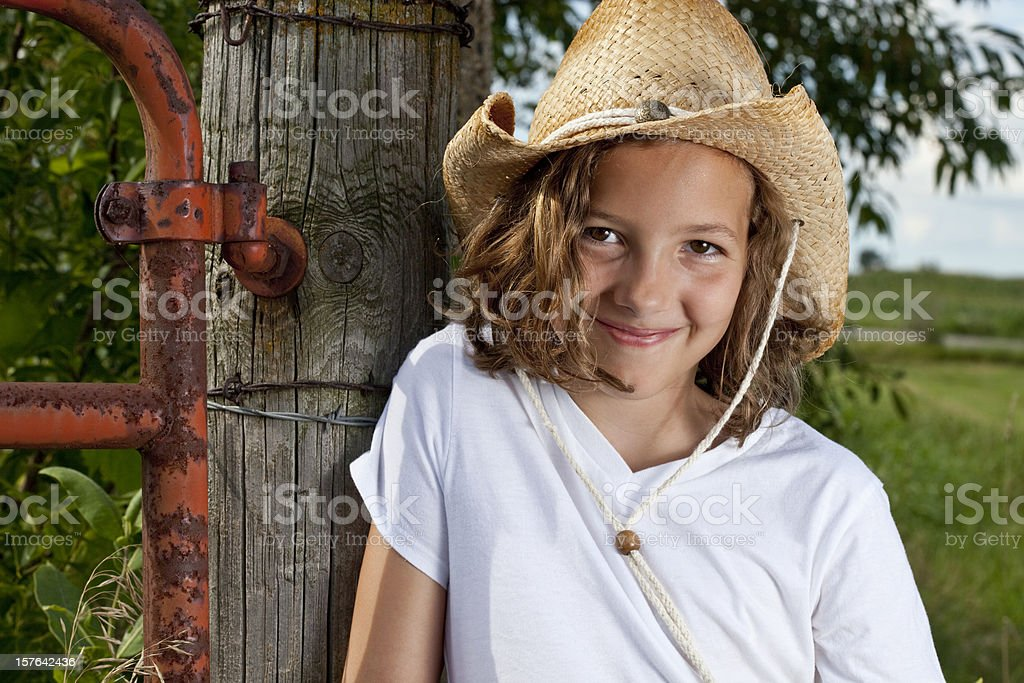 Cute farm girl with cowboy hat royalty-free stock photo