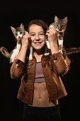 istock Cute fashion little girl with kittens in the arms. 1296570517