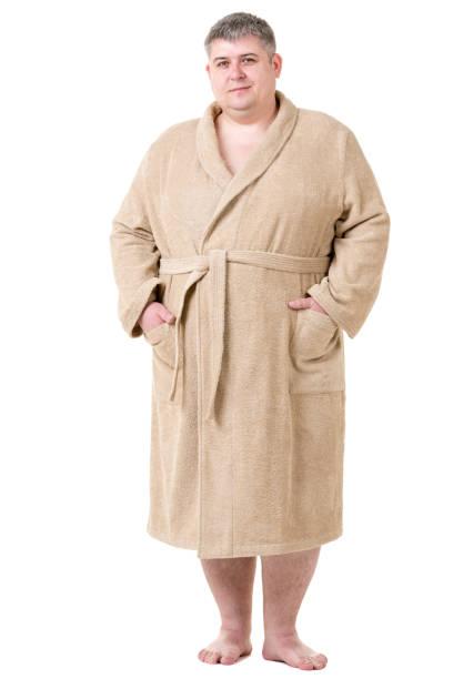 cute fat man in terry cloth bathrobe - accappatoio foto e immagini stock