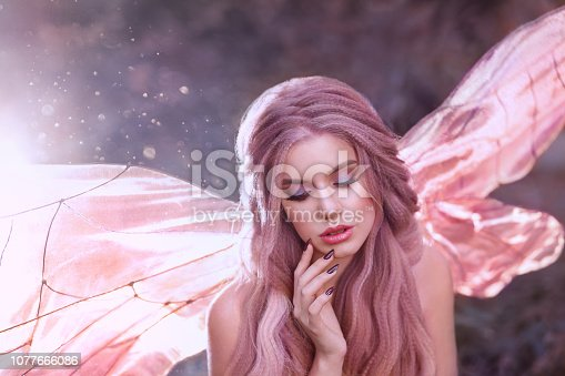 cute faun girl with rose hair with glowing bright pink butterfly wings sit alone in the forest in the morning sun, portrait of a young lady, gorgeous fabulous fantasy photo with highlights.