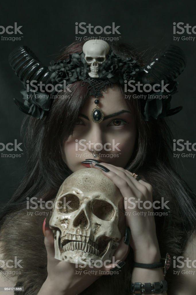 Cute faun with skull stock photo