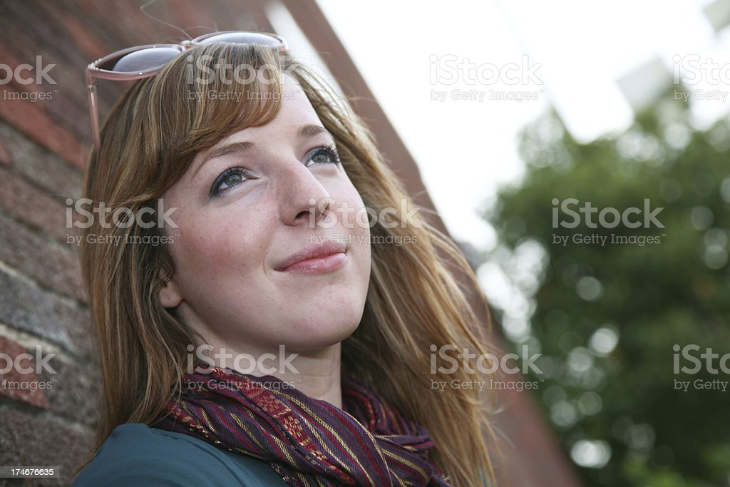 Cute Female Daydreaming While In The City stock photo