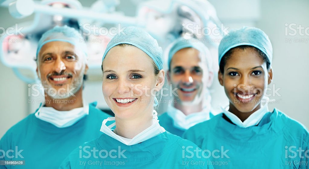 Cute female doctor smiling with team royalty-free stock photo