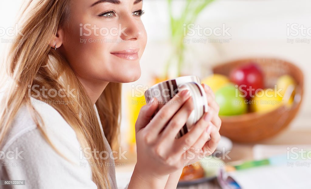Cute female having coffee stock photo