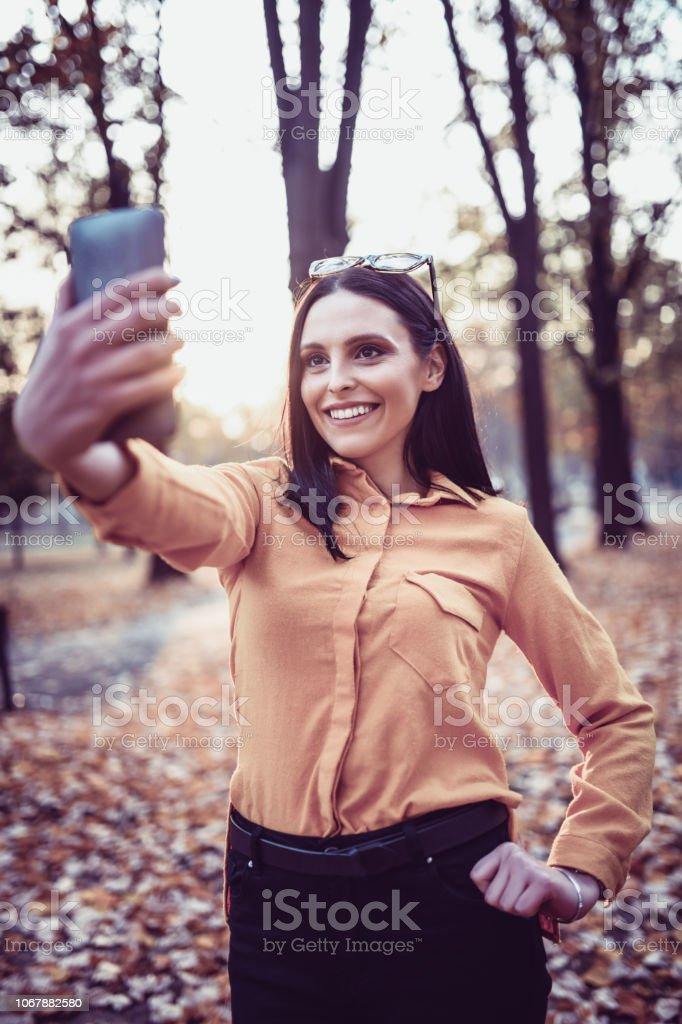 Cute Female Making Autumn Memories stock photo