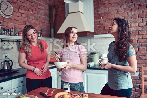 Cute Females Making Dessert Together In Domestic Kitchen