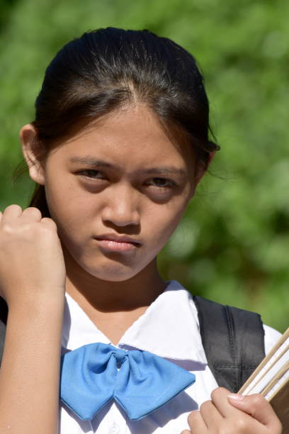 Cute Filipina Female Student And Anger A person in an outdoor setting antagonize stock pictures, royalty-free photos & images