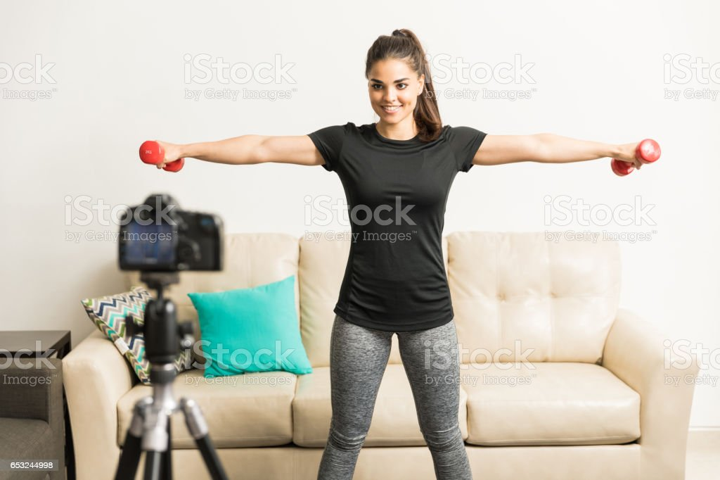 Cute fitness blogger working out stock photo