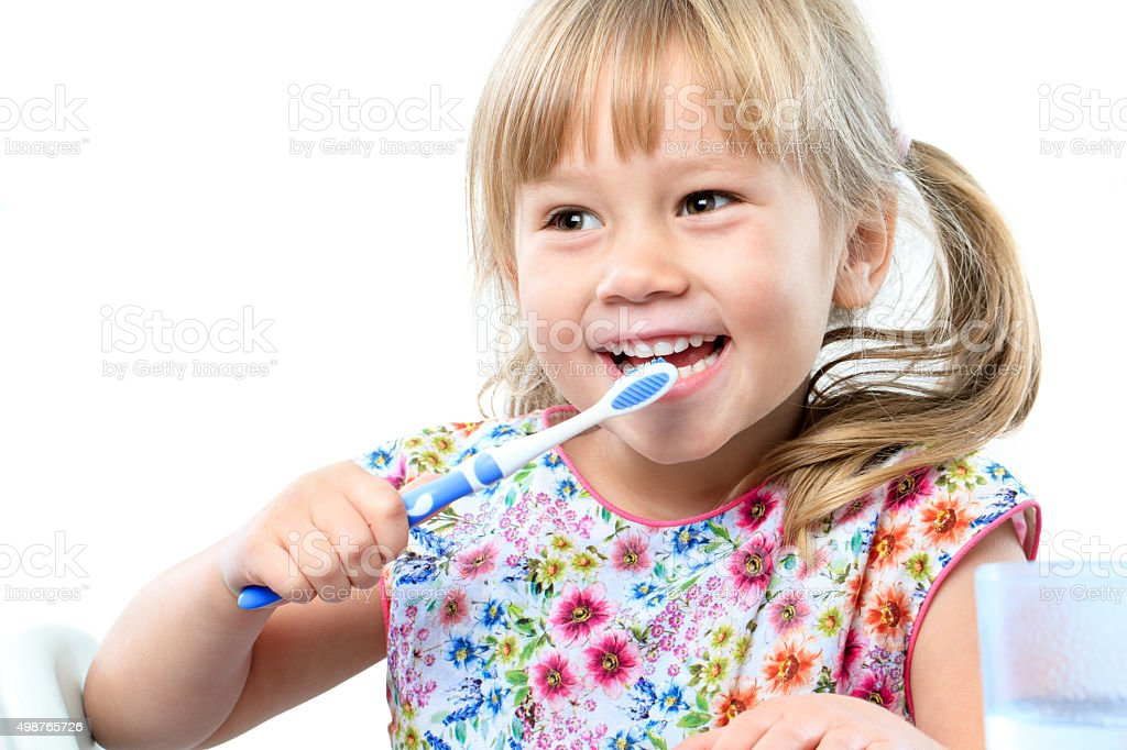 Cute five year old brushing teeth. stock photo