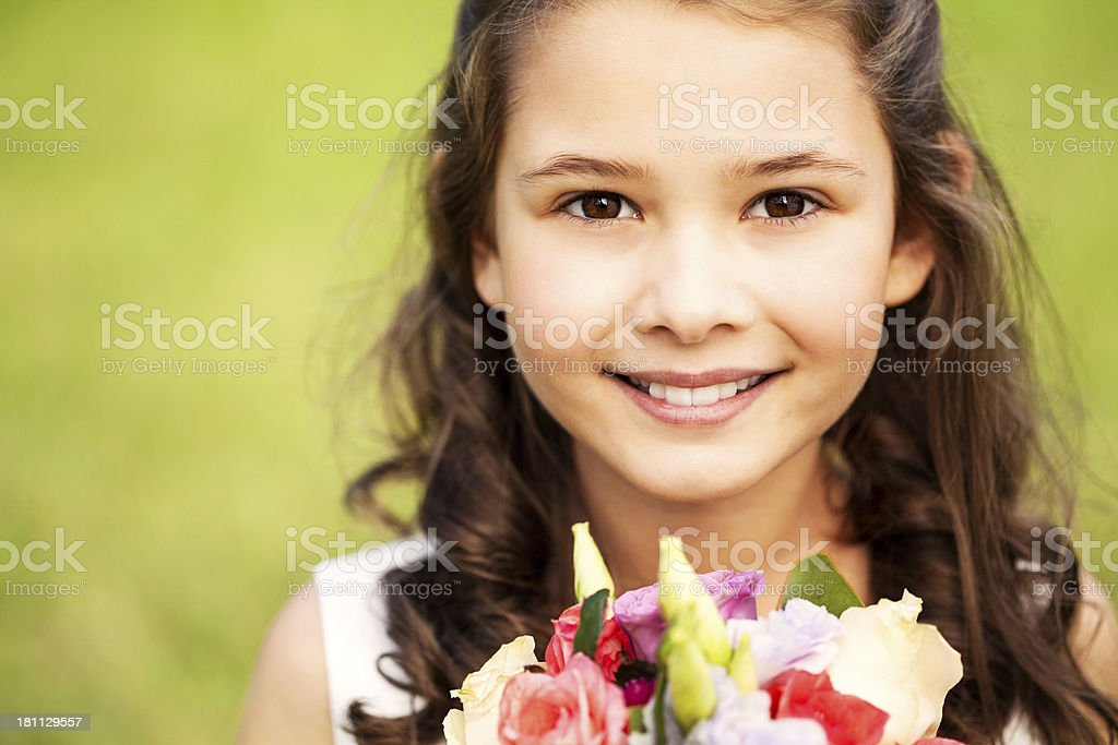 Cute Flower Girl With Bouquet Of Roses In Park royalty-free stock photo