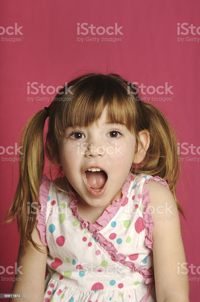 Cute Four Year Old Girl with Pigtails and Pink Background royalty-free stock photo