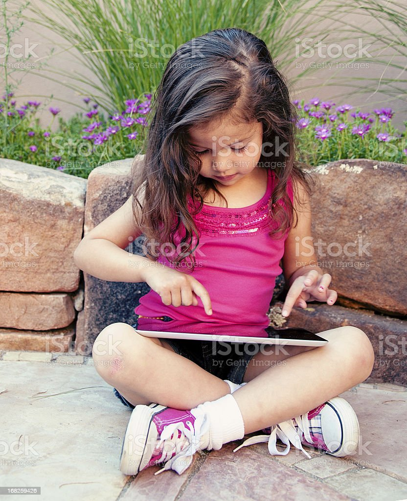 Cute Four Year Old Girl With Touch Screen Tablet royalty-free stock photo