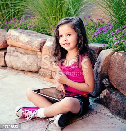 Cute Four Year Old Girl With Touch Screen Tablet Stock