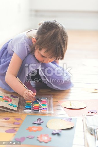 123499844 istock photo Cute Four Years Old Girl Painting DIY Paper Craft 1211594119