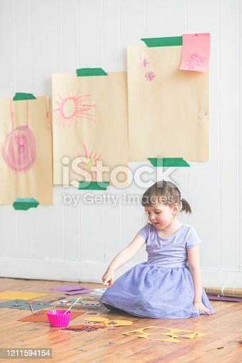 123499844 istock photo Cute Four Years Old Girl Painting DIY Paper Craft 1211594154
