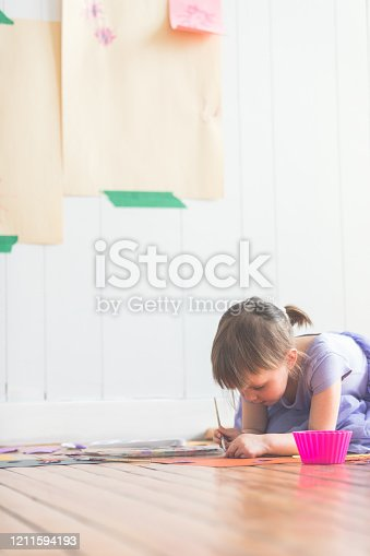 123499844 istock photo Cute Four Years Old Girl Painting DIY Paper Craft 1211594193