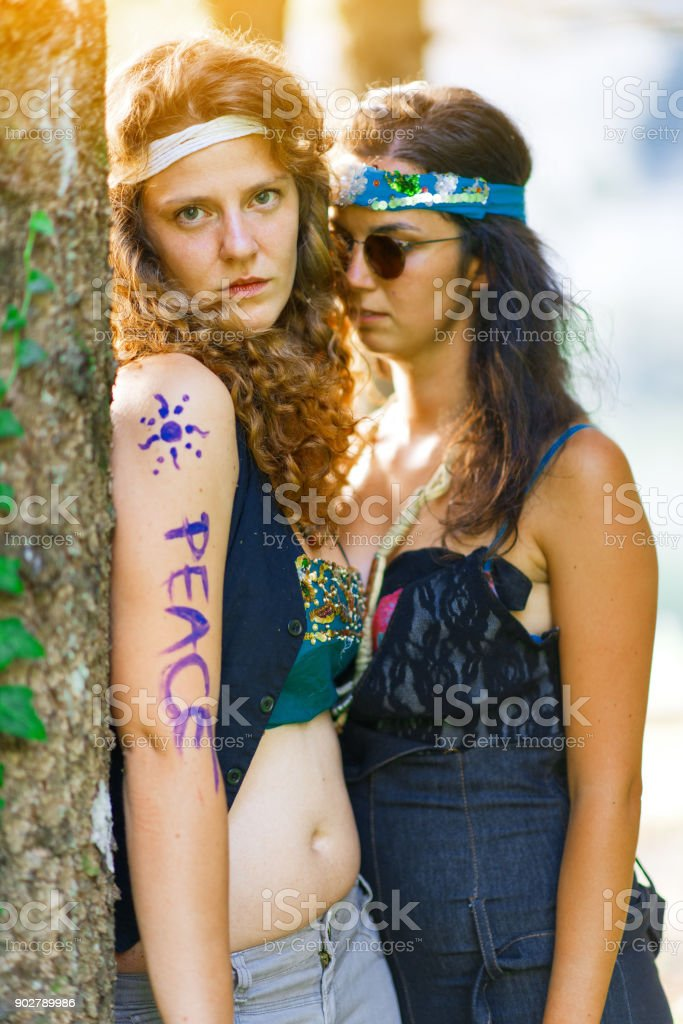 Cute free hippie girls. Free love. - Vintage effect photo stock photo