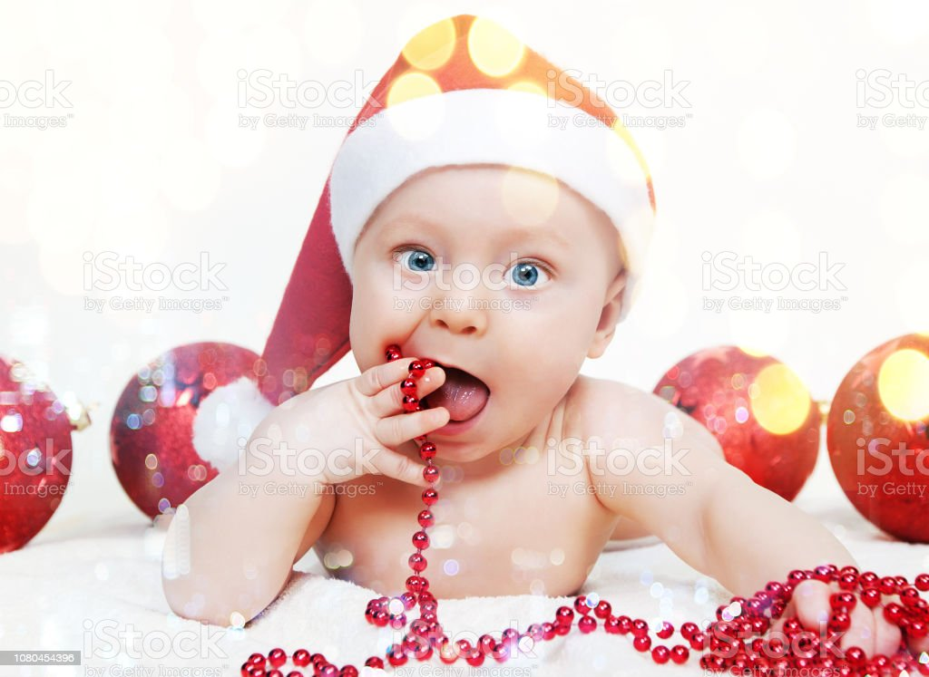 Cute funny baby boy in a Christmas hat stock photo