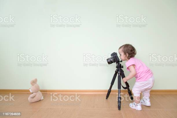 Cute funny beautiful baby in a pink tshirt photographs her bunny the picture id1167264633?b=1&k=6&m=1167264633&s=612x612&h=egysrksnykn9zal dme9hn3vtwodnfnuyp50se078eo=