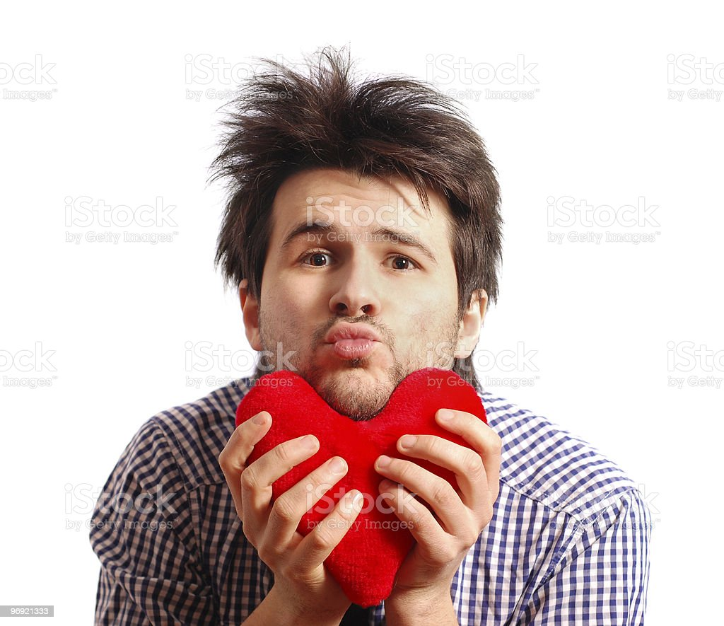 Cute funny young man with toy heart royalty-free stock photo