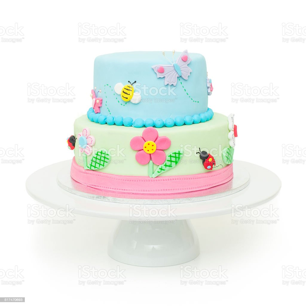 Cute garden themed birthday cake stock photo