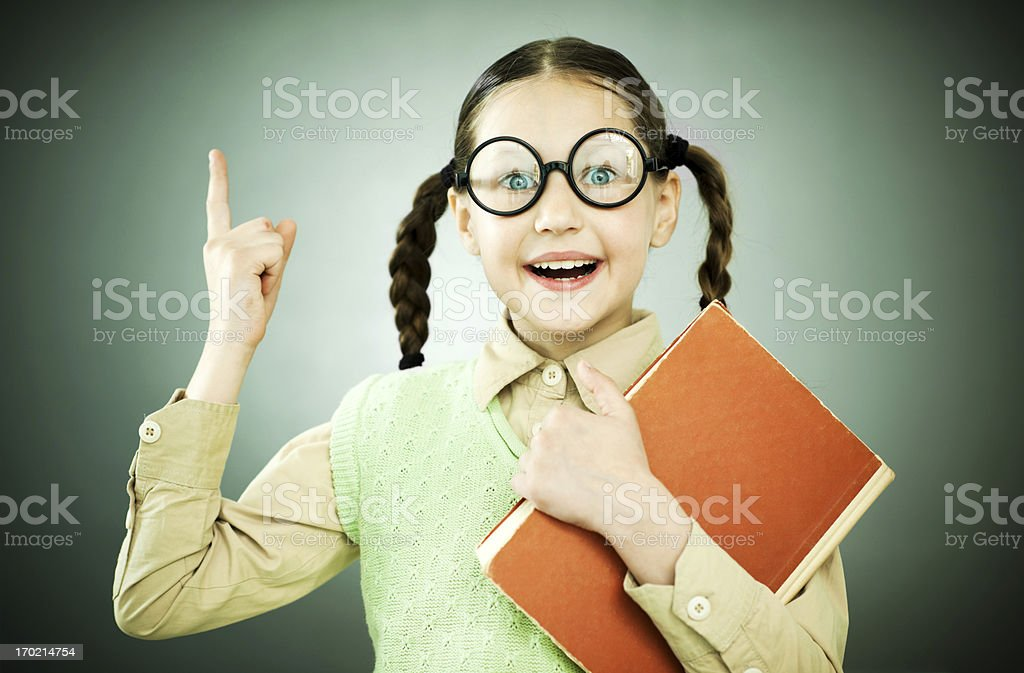 Cute geek girl with piggy tail is holding her notebook. royalty-free stock photo