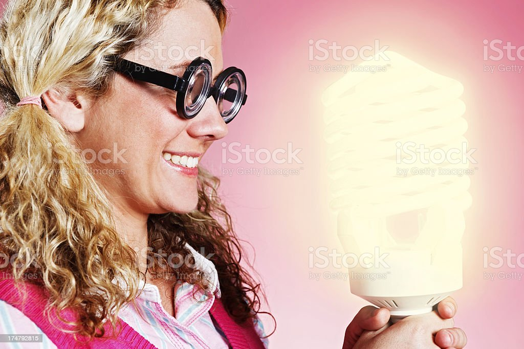 Cute geeky blonde girl has a light bulb moment! royalty-free stock photo