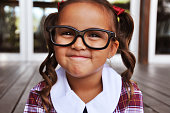 Cute little geeky school girl.