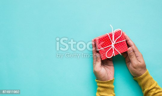 istock Cute gift box in male hand.celebration anniversary and party concepts 874911952