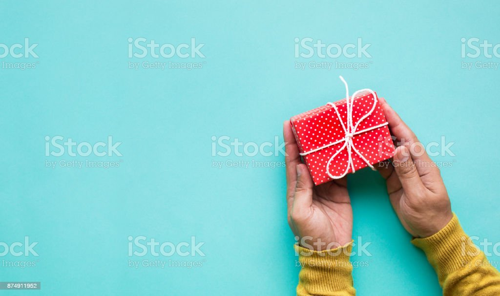 Cute gift box in male hand.celebration anniversary and party concepts stock photo