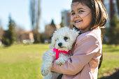 Cute girl and cute puppy