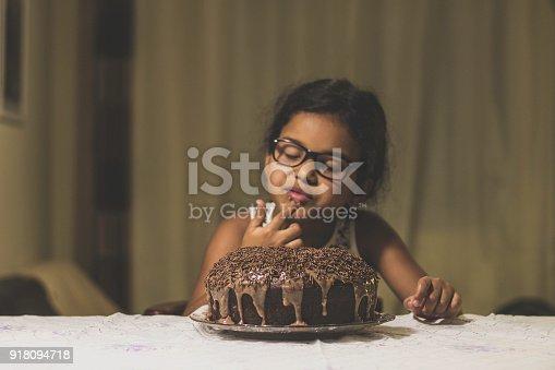 istock Cute girl and delicious brigadeiro cake 918094718