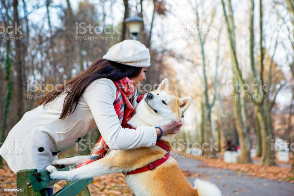 Cute girl and her dog spending day together and having fun royalty-free stock photo