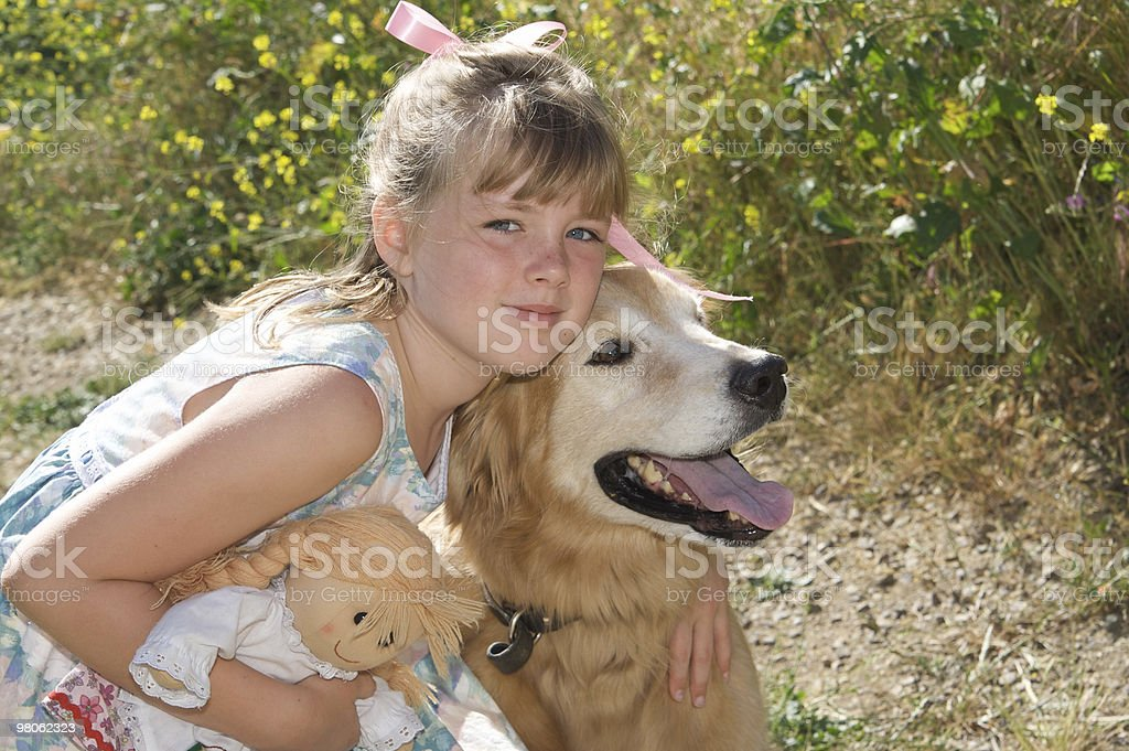 Cute Girl and her Golden Retriever Outdoors royalty-free stock photo