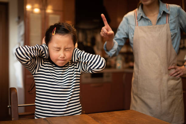 Cute girl angry by mom stock photo