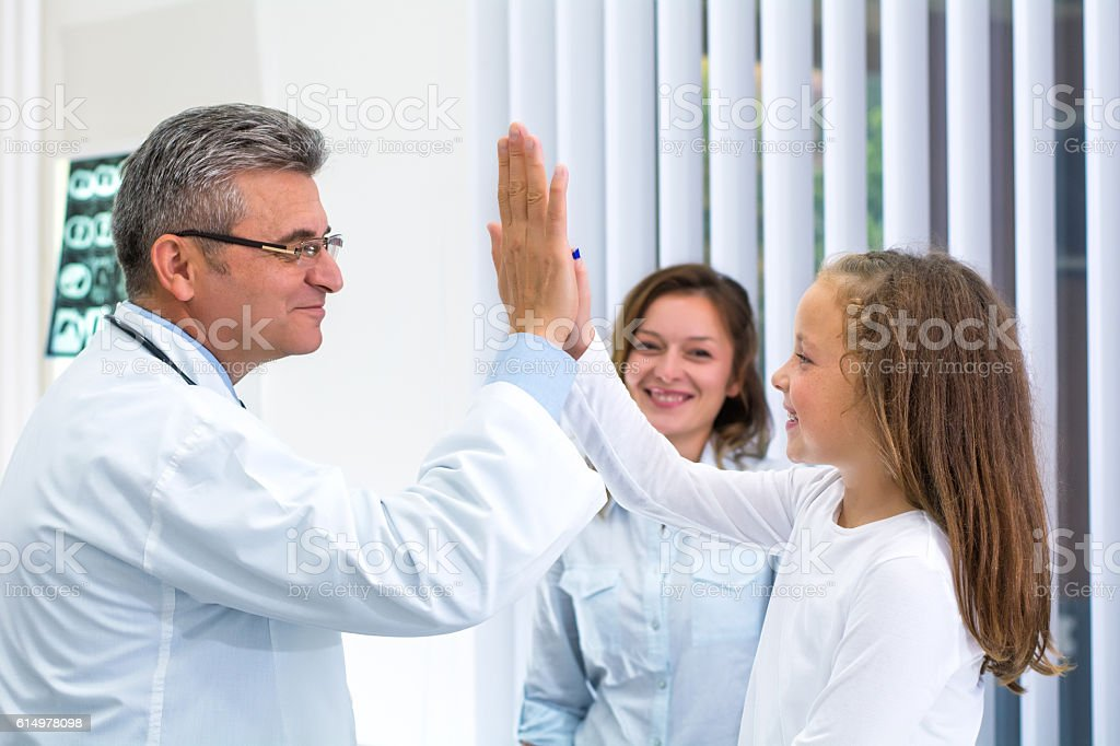 Cute girl at doctor's office. stock photo