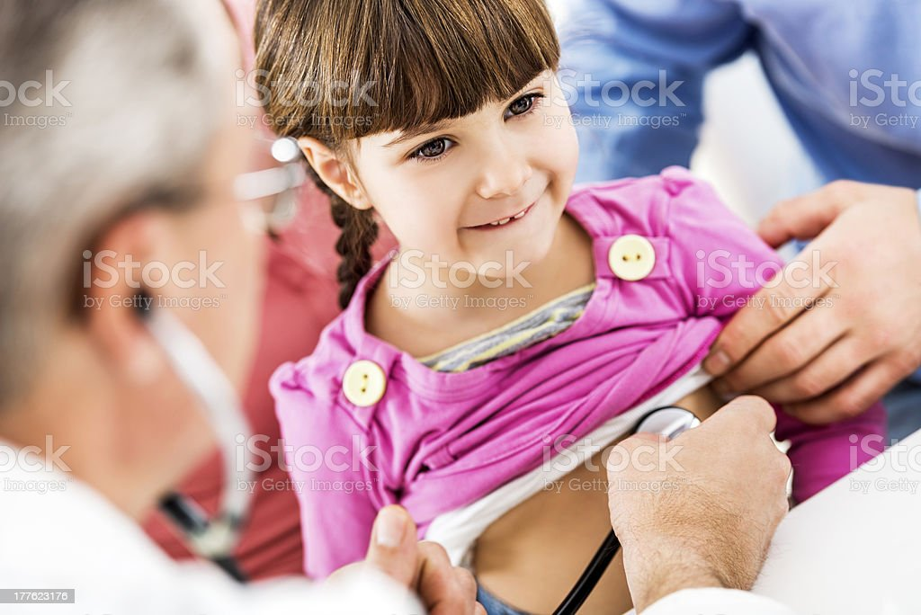 Cute girl at the pediatrician's. royalty-free stock photo