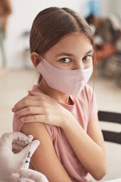 Cute Girl at Vaccination Center stock photo