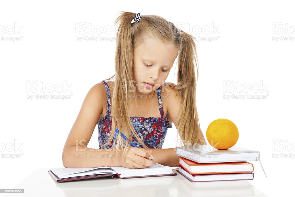 Cute girl does homework royalty-free stock photo