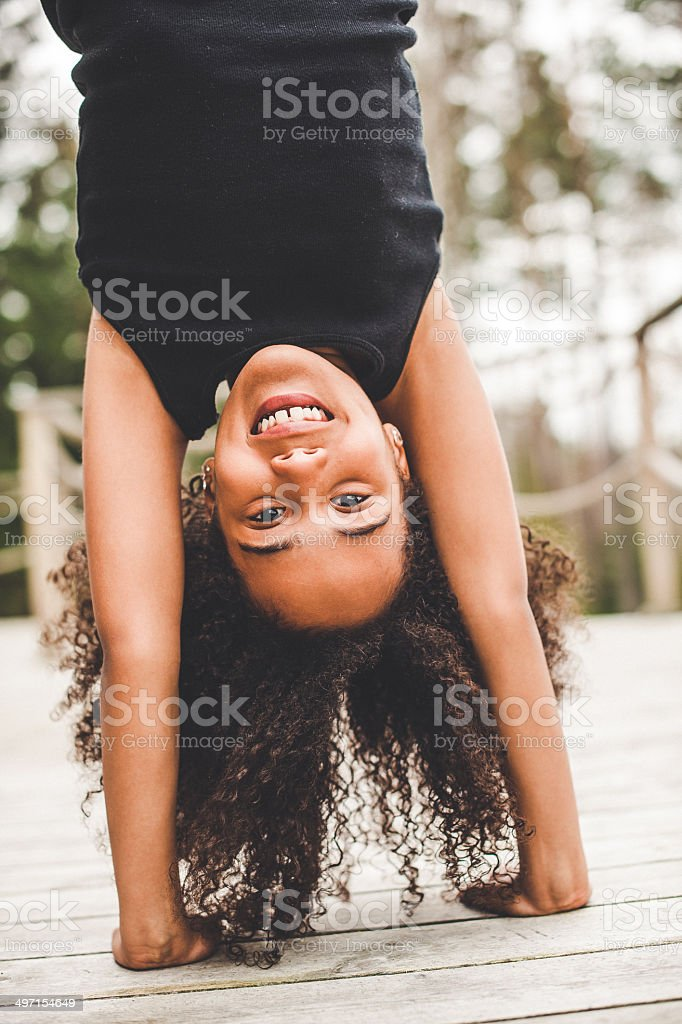 Cute girl doing a dance cheerleading routine stock photo