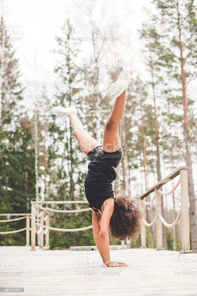Cute girl doing a dance cheerleading routine stock photo
