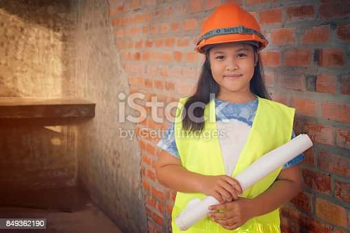 istock Cute girl dress up as a engineer Grow up or be a construction worker 849362190