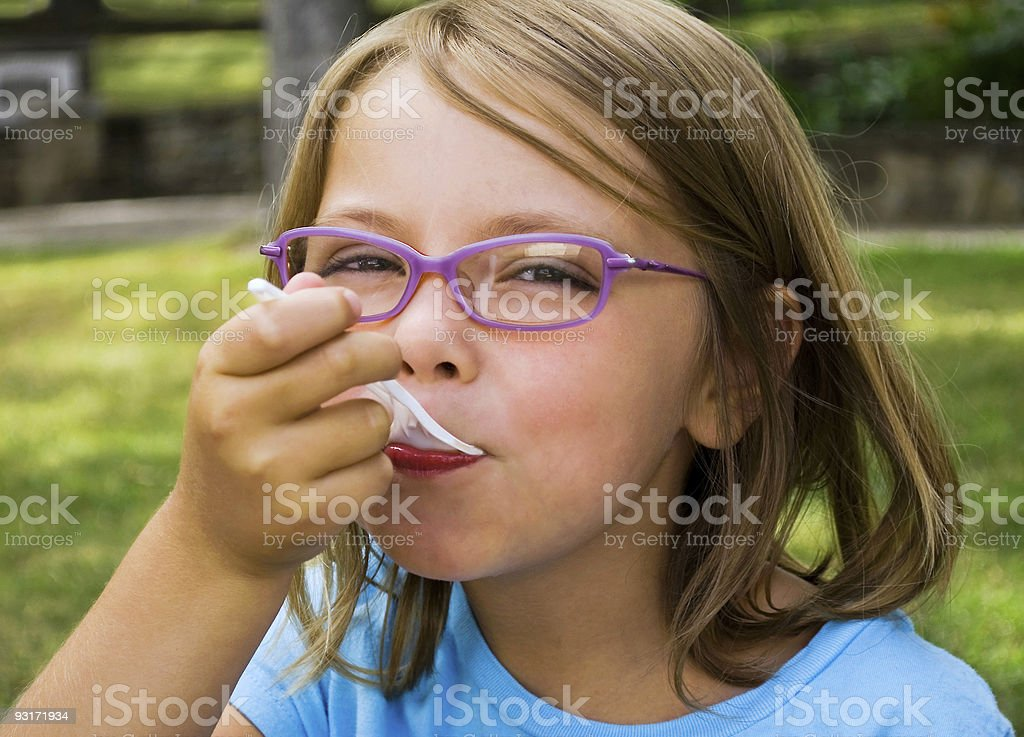Cute girl eating at the park stock photo