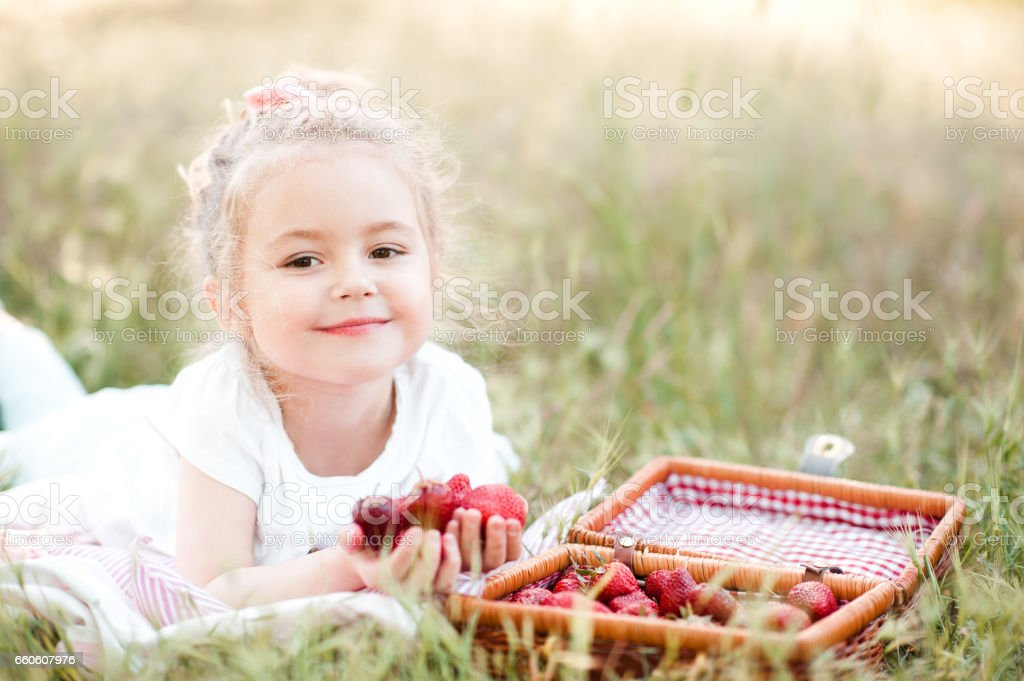 Cute girl eating fruits outdoors royalty-free stock photo